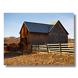 A photo of an barn with a split rail fence in Escalante Utah