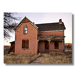 A historic brick house in Escalante Utah found along state route 12.